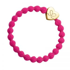 Gold heart charm on a fuchsia hair band, one of a range of fashionable hair bands at byEloise bangle bands.