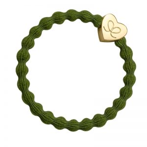 A gold heart charm on an olive hairband bracelet, just one of the fashionable hair bands at byEloise.