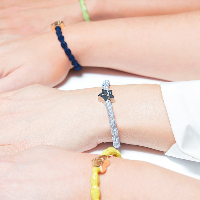 Close up of womens hands, the wrists dressed with byEloise bangle bands.