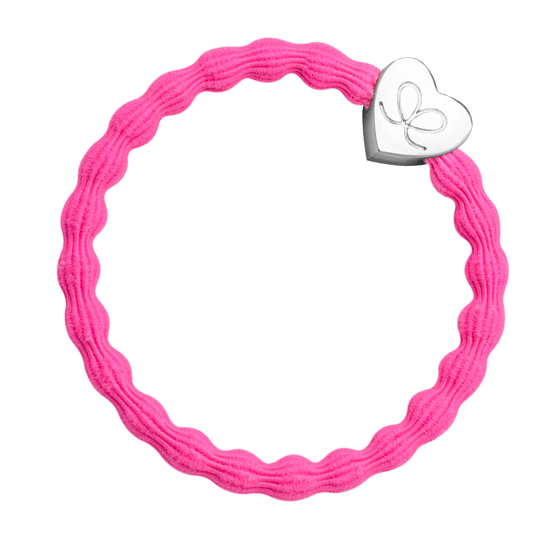 A silver heart on neon pink hairband - ultra fashionable hair bands at byEloise.