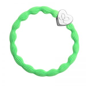 A silver heart on neon lime hairband, part of a huge range of fashionable hair bands at byEloise..