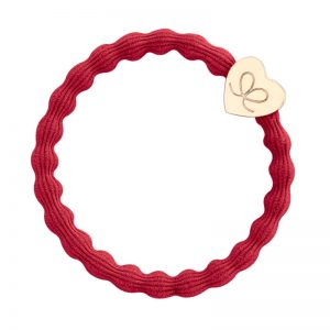Gold heart charm on a cherry red hairband, part of the hairbands and bracelets collection from byEloise.