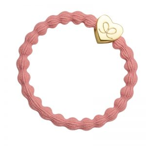 A stunning gold heart charm on a coral hairband - fashionable hair bands from byEloise.