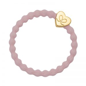 A gold heart charm on a soft pink elastic hair band, part of the byEloise Bangle Bands range.