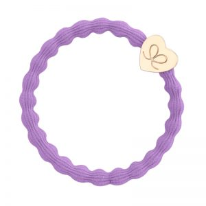 A gold heart charm on a lilac hair band, part of a range of fashionable hair bands at byEloise.