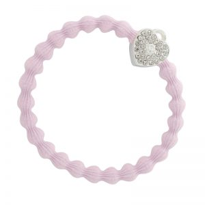 A silver heart lock charm on a soft pink hair band, one of the fashionable hair bands from byEloise.