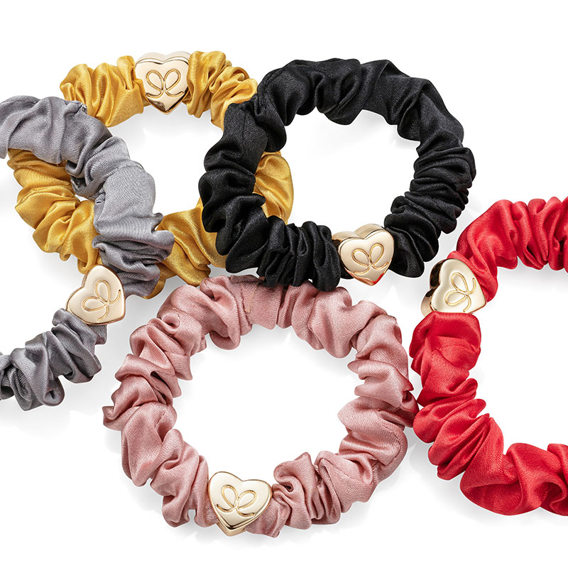 Numerous byEloise London silk scrunchie bangle bands with gold heart charms.