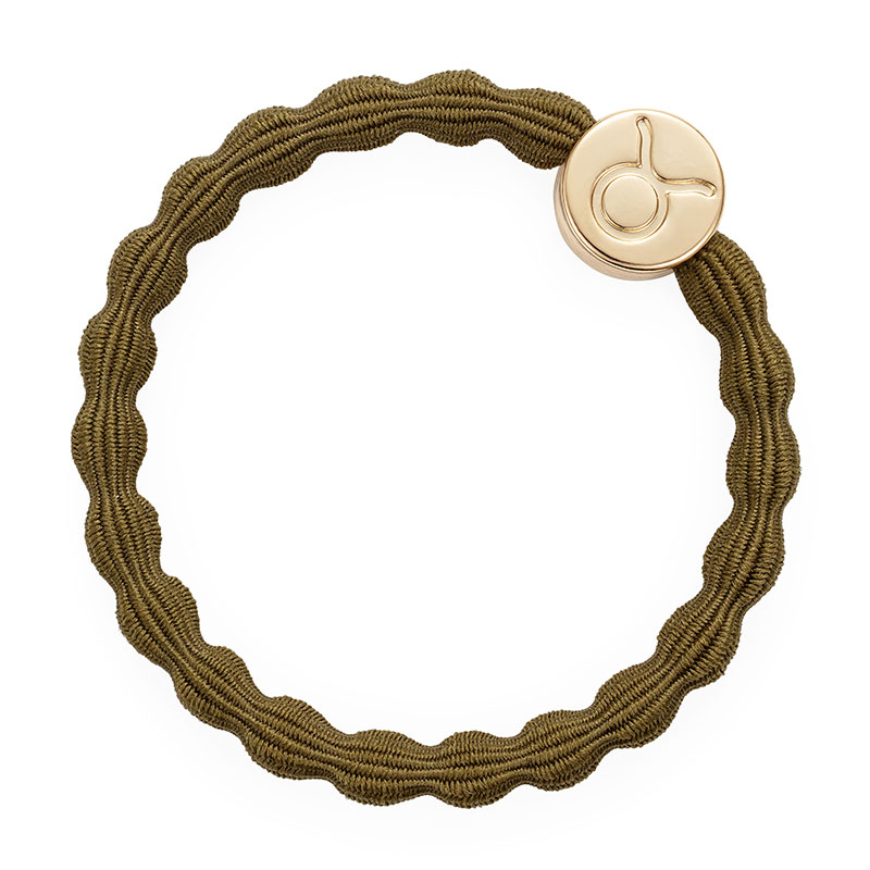 A Taurus zodiac charm on an olive elastic hairband, one of the hair accessories available at byEloise London.