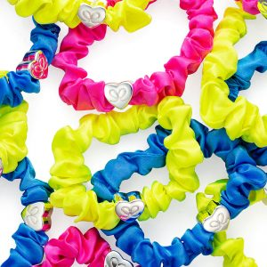 Neon coloured byEloise silk scrunchie bangle bands adorned with silver charms.