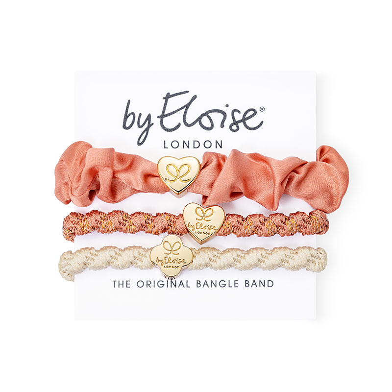 Peaches and cream set of byEloise bangle band hairband bracelets with gold heart and quatrefoil charms.