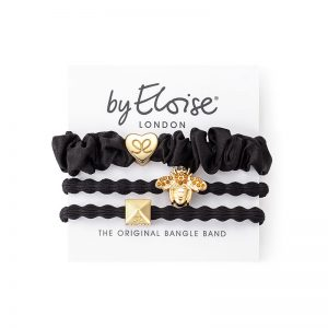 A set of byEloise London black silk scrunchie bangle bands, one with a glittery gold bee charm.