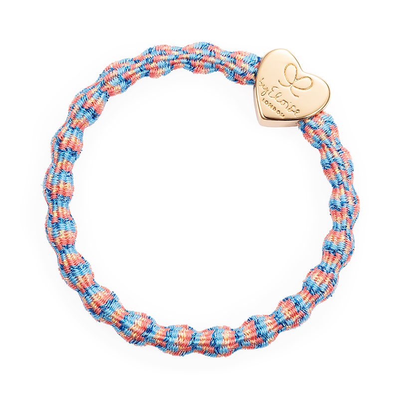 A metallic byEloise gold heart charm on a coral reef coloured hair band bangle.