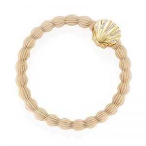 A seashell sand coloured hairband bangle, one of the fashionable hair bands available from byEloise London.